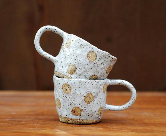 "Handmade Polka Dot Coffee Cup, $39.95 by [Liquorice Moon Studios](https://www.etsy.com/listing/577139127/red-moon-cup-handmade-polka-dot-coffee?ref=shop_home_active_10|target=""_blank""