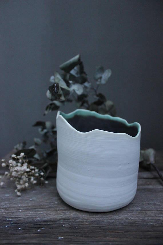 "Handmade porcelain planter, $30, by [Honey Scrumbles](https://www.etsy.com/listing/574424570/mountain-planter-handmade-ceramic?ga_order=most_relevant&ga_search_type=handmade&ga_view_type=gallery&ga_search_query=ceramic&ref=sr_gallery-1-33|target=""_blank""
