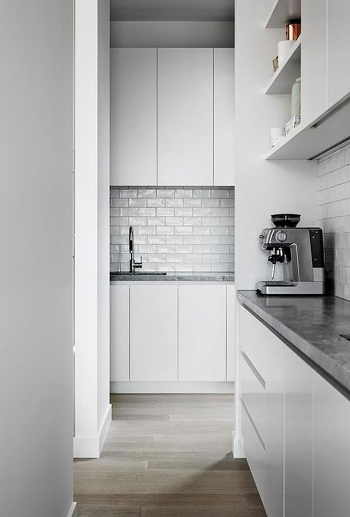 "Simplistic white cupboards and glossy tiles create a minimal, yet refined butler's pantry that connects to the kitchen area through an open entry point [in this glamorous Bloglovin kitchen](https://www.pinterest.com.au/pin/305611524696874522/|target=""_blank"")."