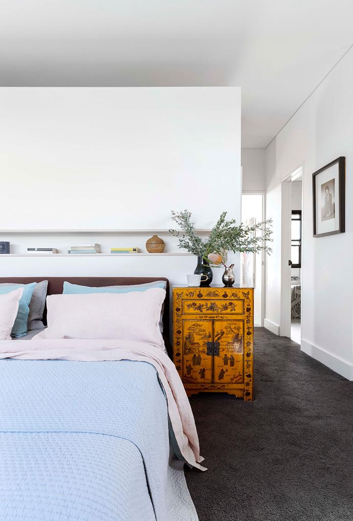 "An antique Chinese chest graces this parents' retreat. Bed, Freedom. Linen, Pure Linen. Wooden bowl, Georg Jensen. The 'Soft.e' carpet from Flooring Xtra, made from recycled PET bottles, is ""beautifully soft"", says Peter."
