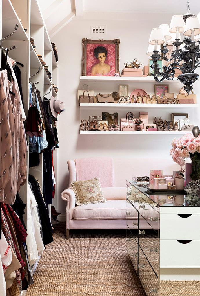 A mirrored dresser with crystal drawer knobs, paired with a millennial pink couch creates a sense of luxury and elegance within this walk-in wardrobe inside Real Housewives of Melbourne star, Chyka Keebaugh's, home. *Photo: Martina Gemmola | Story: Australian House & Garden*