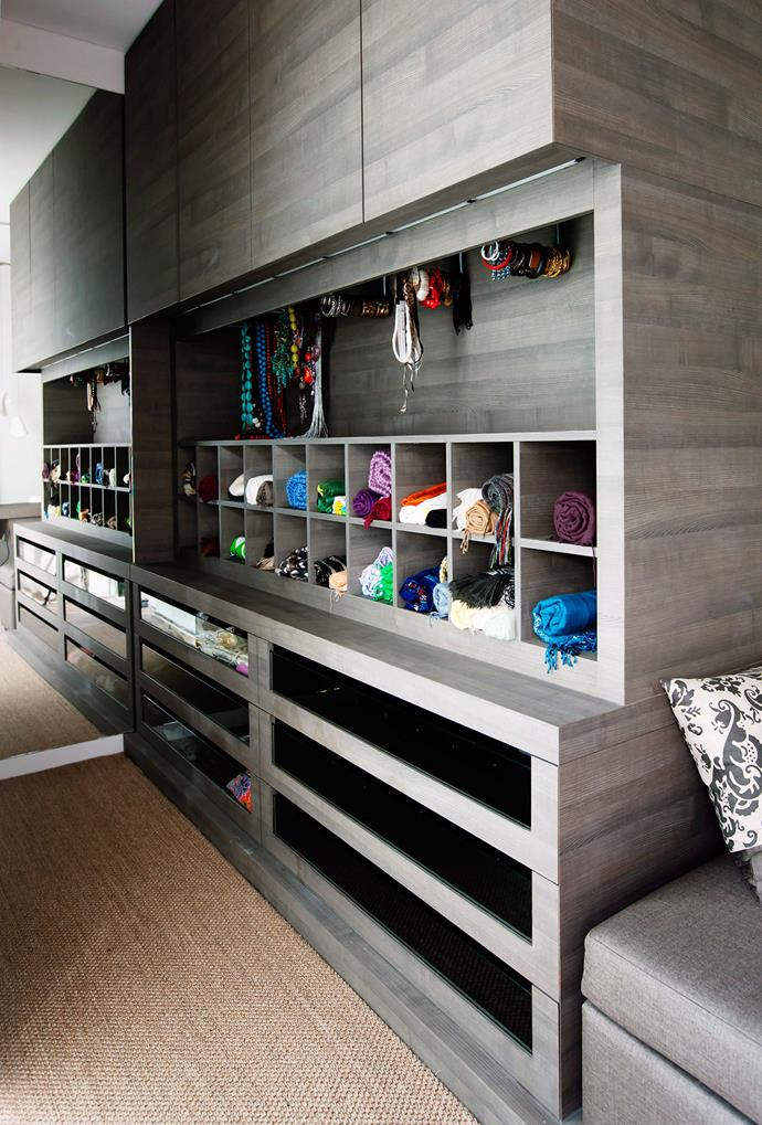 Custom made cabinetry fitted with LED strip lights create a uniformed walk-in wardrobe with endless storage. *Photo: Maree Homer | Story: Australian House & Garden*