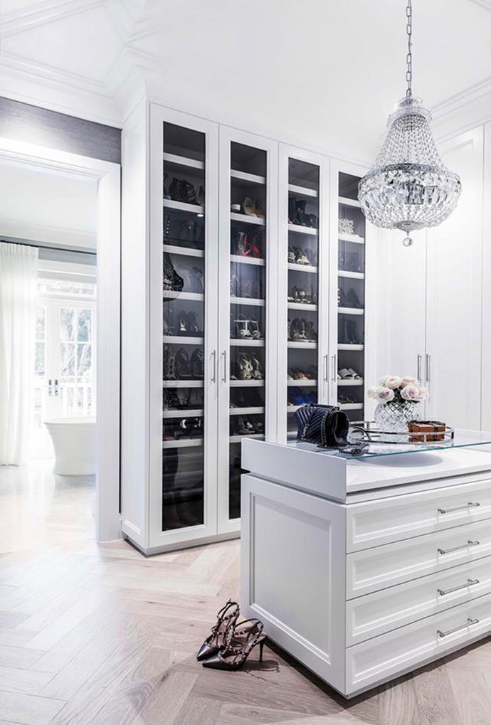 Glass-fronted shoe cabinets and a large crystal chandelier boast luxury in this Hamptons style home in Sydney's Eastern Suburbs.