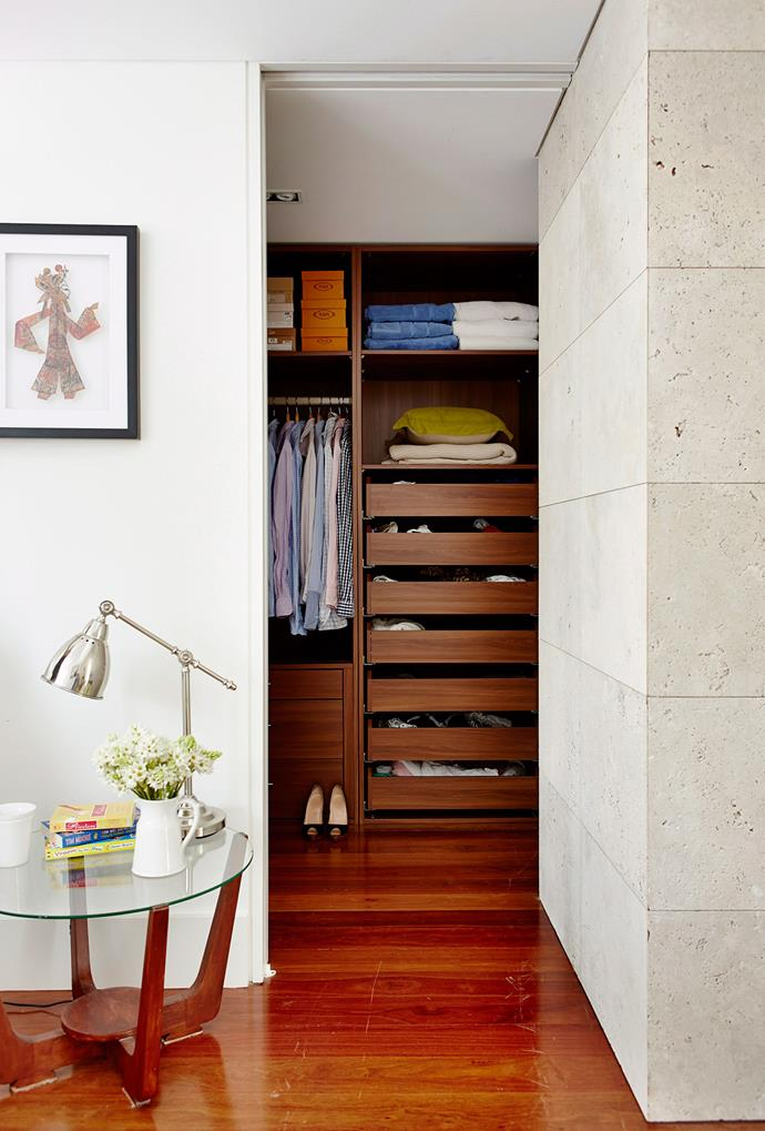 Simplistic timber shelving creates a minimal, yet polished walk-in wardrobe that connects to the master bedroom through an open entry point. *Photo: John Paul Urizar | Story: Australian House & Garden*