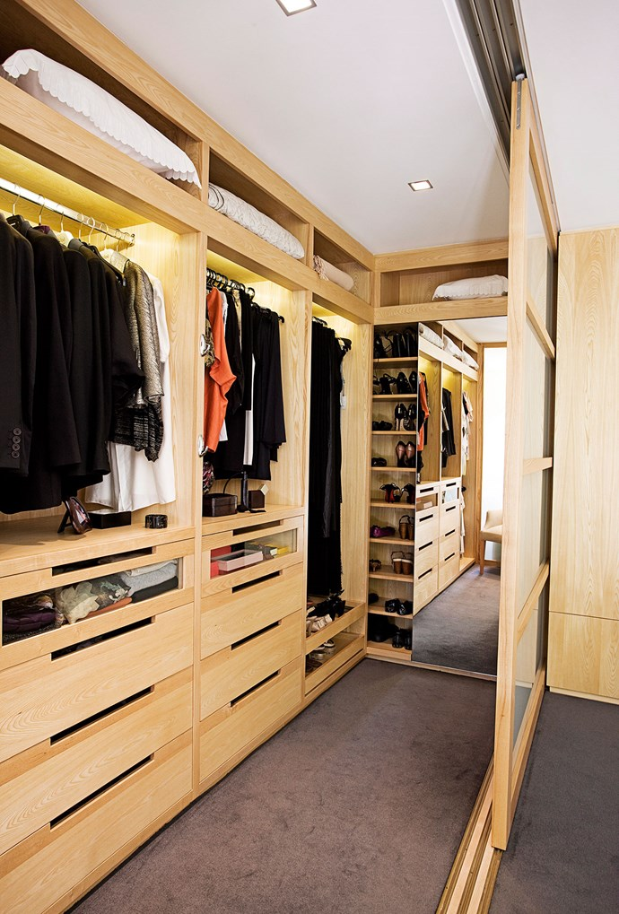Sliding doors in this master bedroom create an easily accessible walk-in wardrobe that can also become it's own space. *Photo: Nick Scott | Story: Real Living*