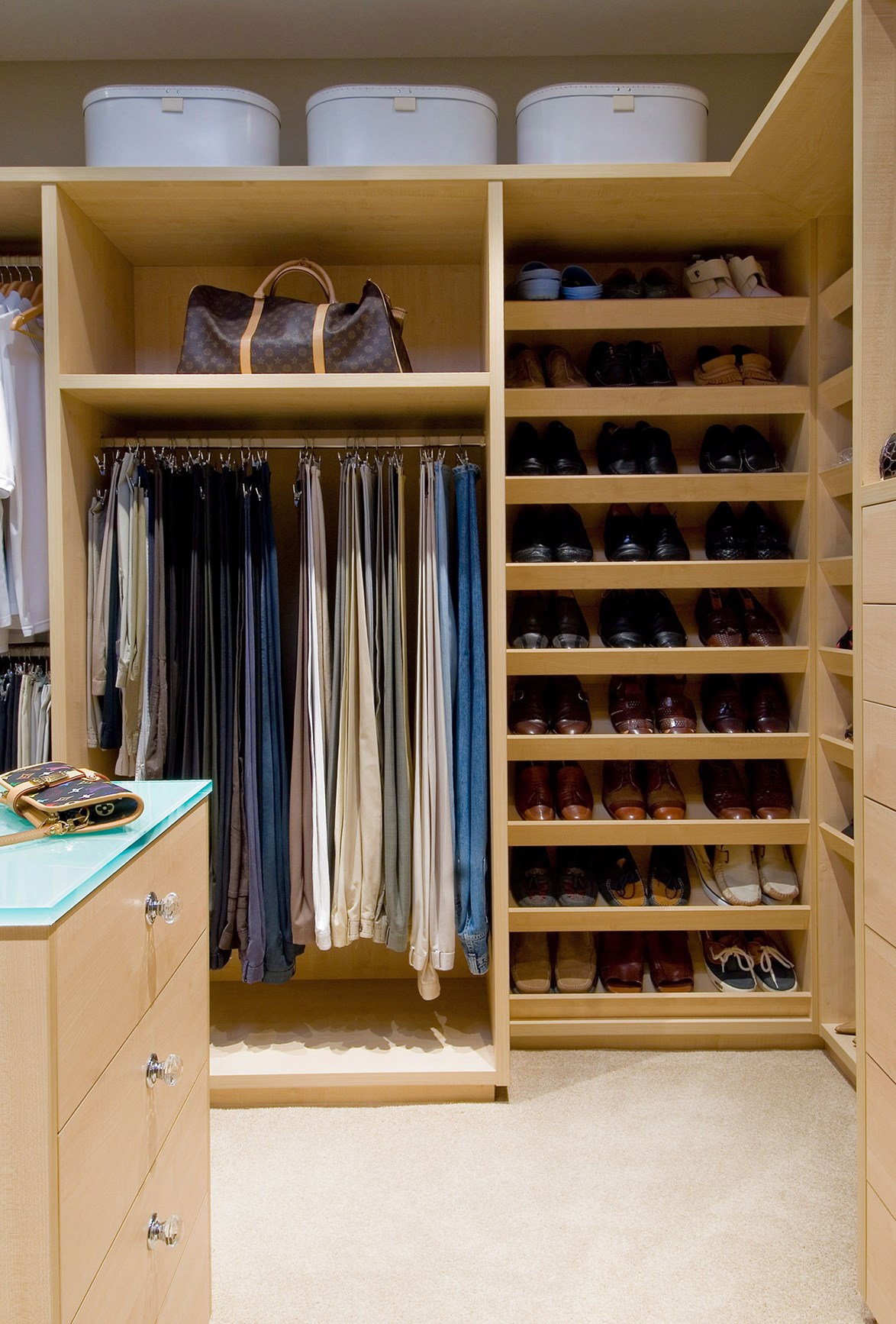 A well-designed wardrobe should have a mixture of storage solutions. Photo: Steve Ryan