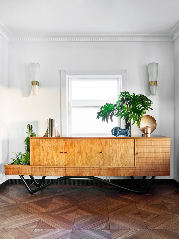 Studio Henry Wilson 'Surface Sconce' atop the right of the 1950s 'Bossa Nova' credenza by Giuseppe Scapinelli.