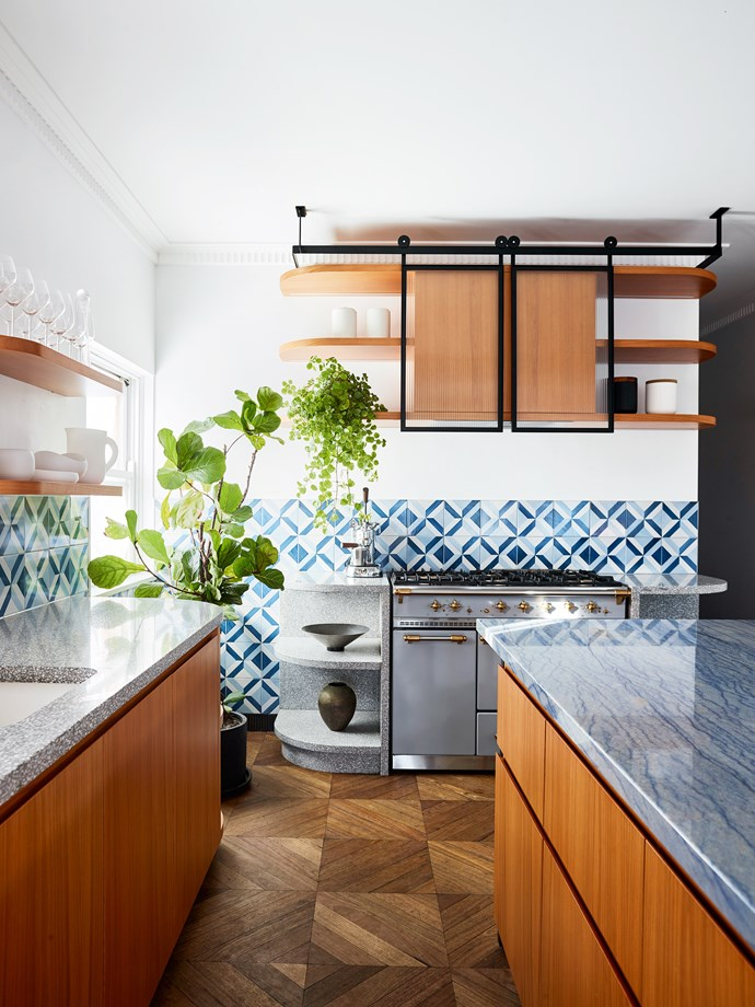 Custom curved terrazzo shelving designed by SJB with custom terrazzo bench by Terrazzo Australian Marble and American oak joinery by Fisher Fitouts. 'Blu Ponti' tiles by Gio Ponti and walls in Porter's Paints 'K2'. Lacanche oven.