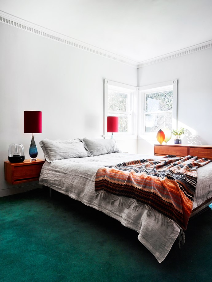 In the bedroom, Westmorland hand-blown glass lamps by Stewart Hearn. Mid-teal carpet from RC+D.