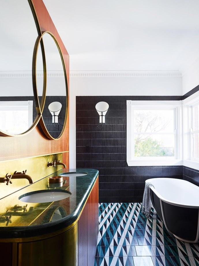 'Backgammon' bathroom floor tiles by Gio Ponti with Inax 'Yuki Border' wall tiles from Artedomus. Designheure 'Baby Cargo' wall lights.