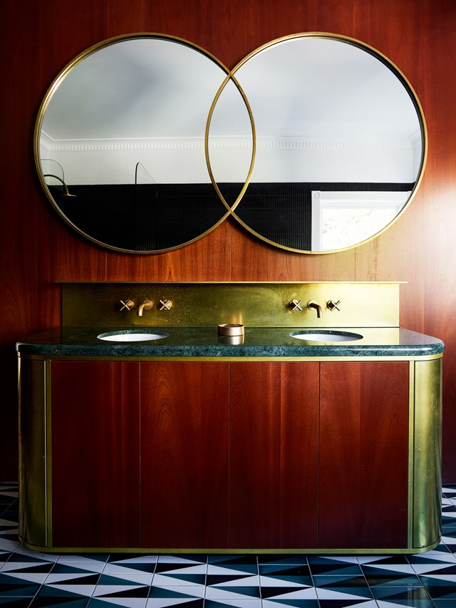 "Brass accents, curved lines and a jade-coloured marble benchtop combine to create an Art Deco feel in [bathroom of this renovated Bondi home](https://www.homestolove.com.au/makeover-of-an-art-deco-apartment-in-bondi-6291|target=""_blank""). *Photo: Anson Smart*"