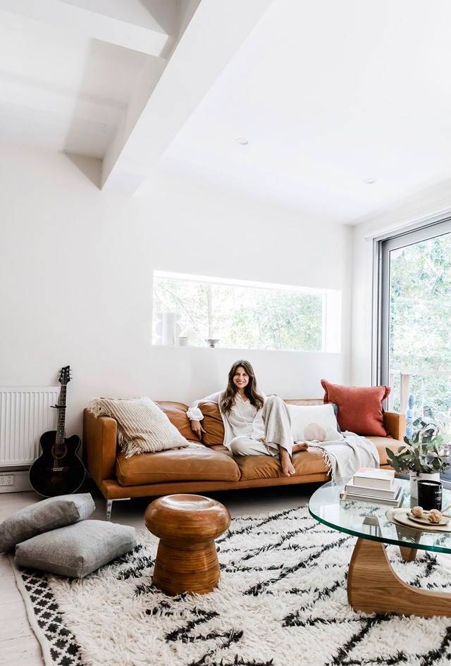 "[Carla Oates, founder of The Beauty Chef](https://www.homestolove.com.au/inside-the-beauty-chef-carla-oates-stunning-bondi-home-6292|target=""_blank""), takes a minimalist approach to boho style, filling her home with beautifully designed, purposeful pieces and natural textures. Greenery is also ever-present, bringing wellbeing and positivity into the house. *Photo:* Maree Homer"