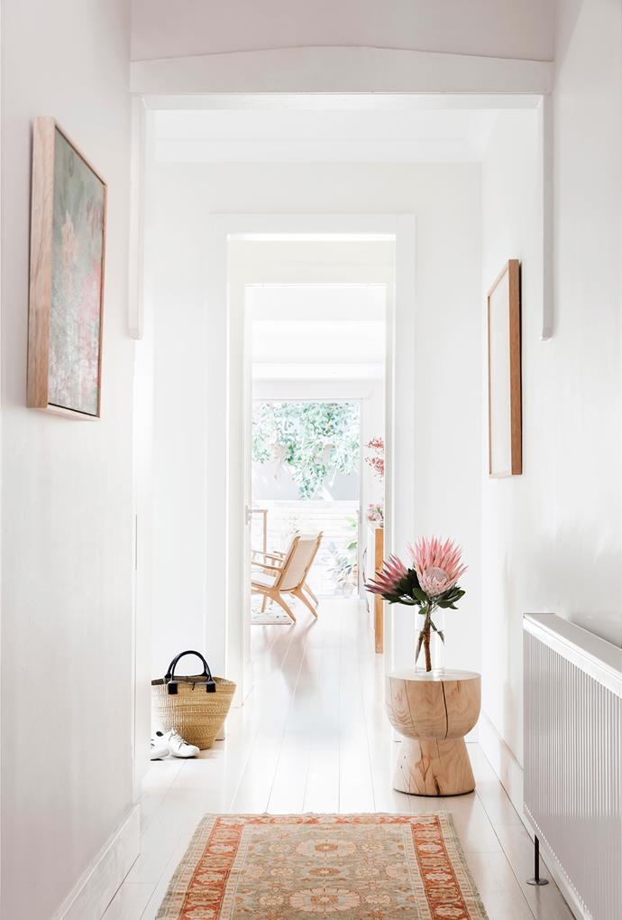 """Carla has a few stools around her home – this one in the hallway is by Mark Tuckey. """"I find them very practical and sculptural,"""" she says. """"They make great side tables, foot stools and seats."""" The rug is from Cadrys – """"It's very pretty and earthy at the same time,"""" she adds."""