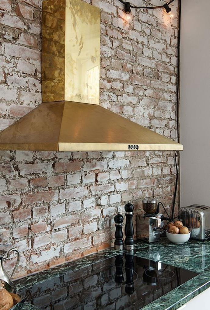 """The brass-gold canopy rangehood is enhanced by an exposed brick wall and a green marble benchtop, reminiscent of rustic style. *[Bloglovin' via Pinterest](https://www.pinterest.com.au/pin/690176711616188622/