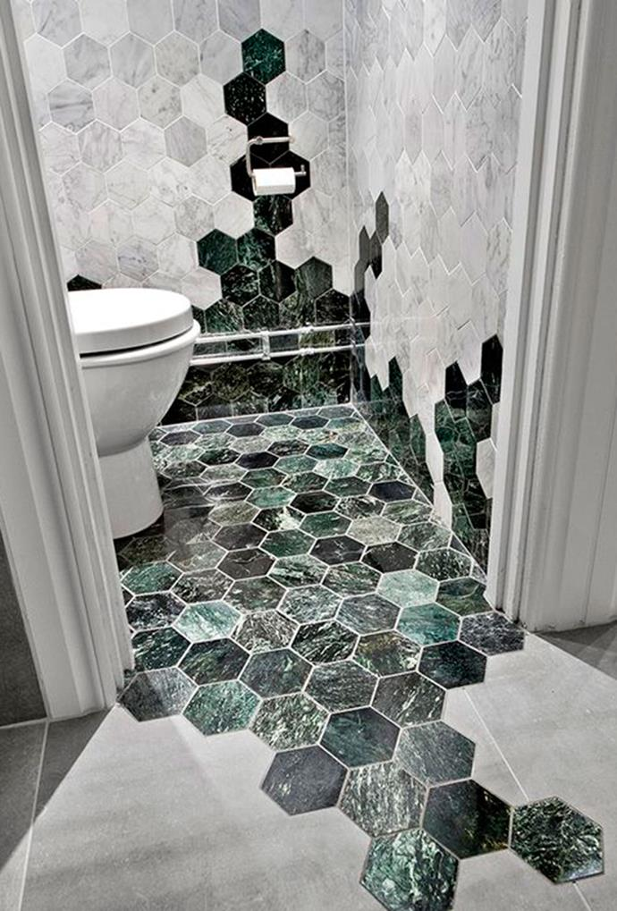 """Green and grey hexagonal marble tiles, mixed with large matte square floor tiles, bring pattern, texture and visual contrast into this modern home. *[Roomed via Pinterest](https://www.pinterest.com.au/pin/113153009368615519/