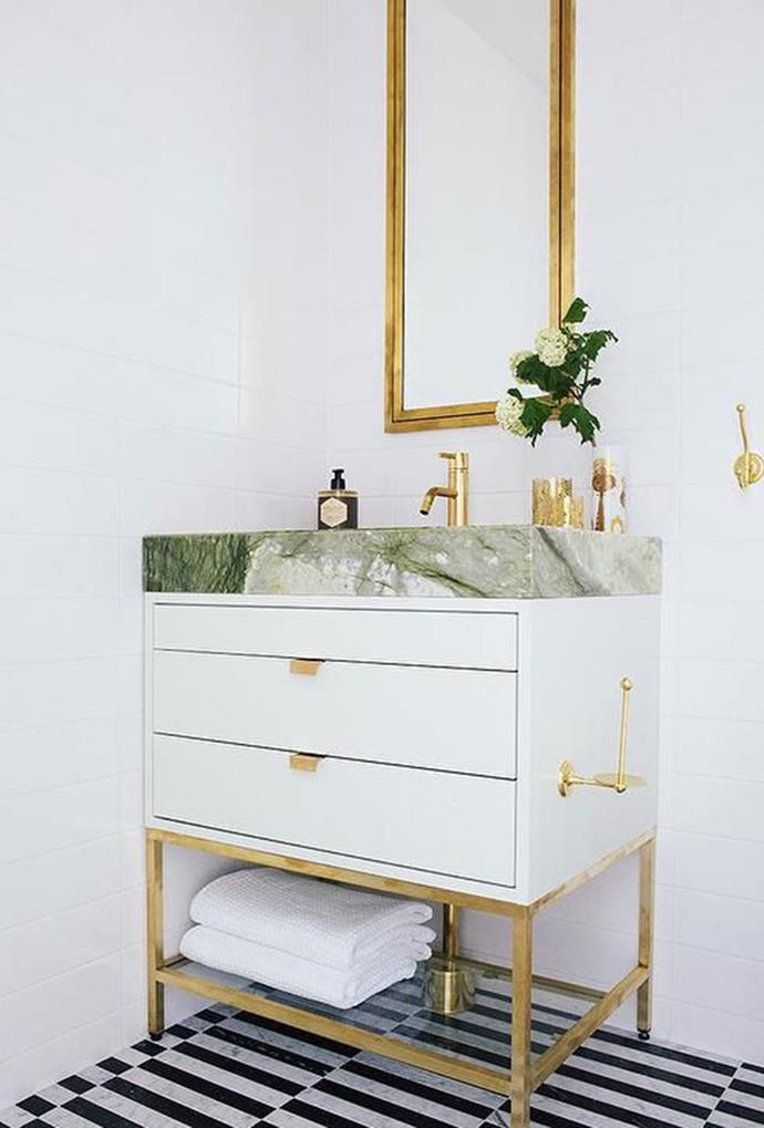"""A green marble benchtop accented by a gold-framed mirror and gold appliances, create a simplistic, yet elegant bathroom design that will last the test of time. *[DecorPad via Pinterest](https://www.pinterest.com.au/pin/ARTReKYmbpsttDb-gqB8W34xhkv3KBGwr0eaK49fSbgdfP_K_2xN2t4/
