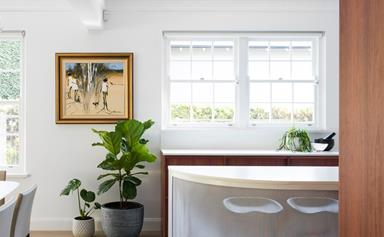 Mid-century modern makeover of a dated 90s kitchen