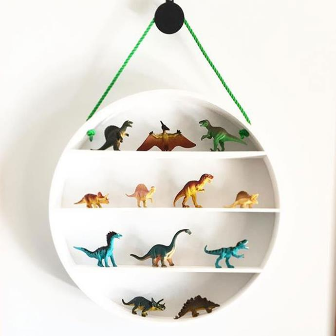 "**Plywood Shelf Turned Wall Art** <br><br> This plywood round wall shelf has been painted white and hung on a bright green rope — the perfect way to store and display toys. *Photo via: [@sammy_sheppard](https://www.instagram.com/p/BekvafplydN/?tagged=kmarthacks|target=""_blank""