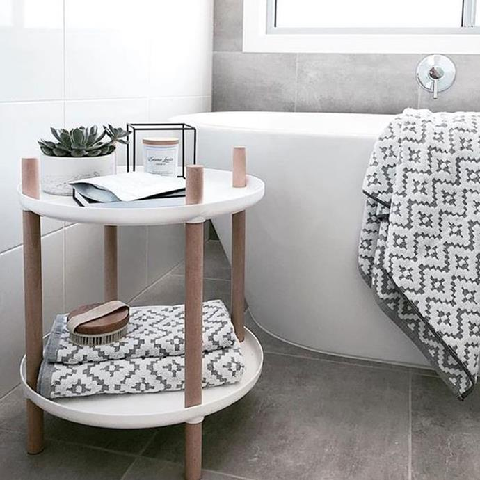 "**Deconstructed Side Table** <br><br> The wheels of this two level table have been removed to create a simple, yet stylish bath-side table. *Photo via: [@styledonbudget](https://www.instagram.com/p/BeSh0qflaGi/?tagged=kmarthacks|target=""_blank""