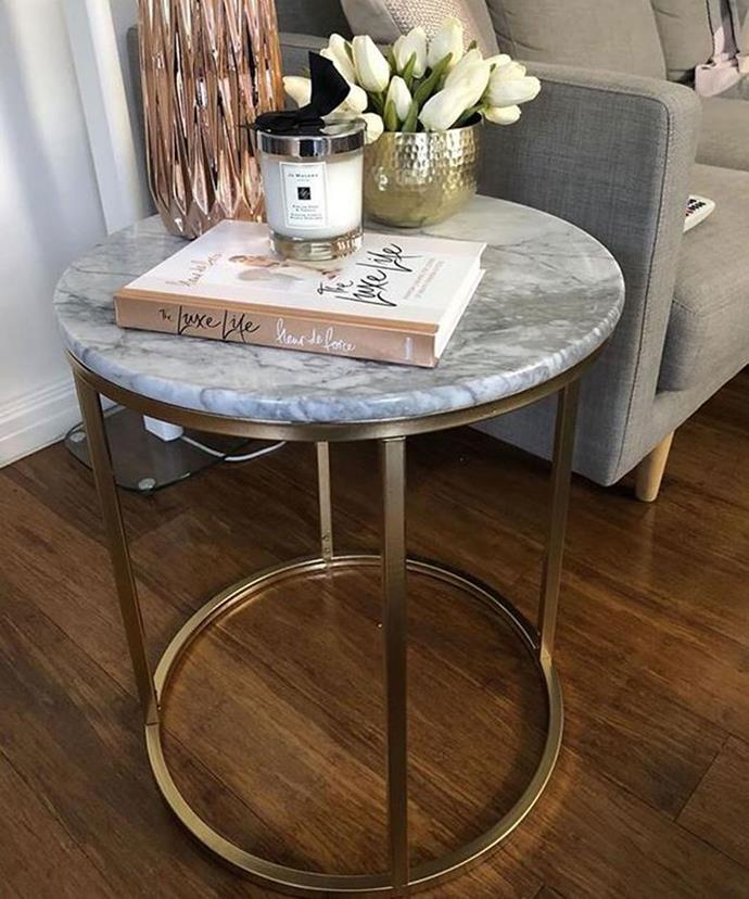 "**Inexpensive Coffee Table Gets Luxe Revamp** <br><br> The black legs of this side table were spray painted gold, creating an illusion of luxury. *[@kmart_new_finds](https://www.instagram.com/p/Bd7OcZShUSA/?tagged=kmarthack|target=""_blank""