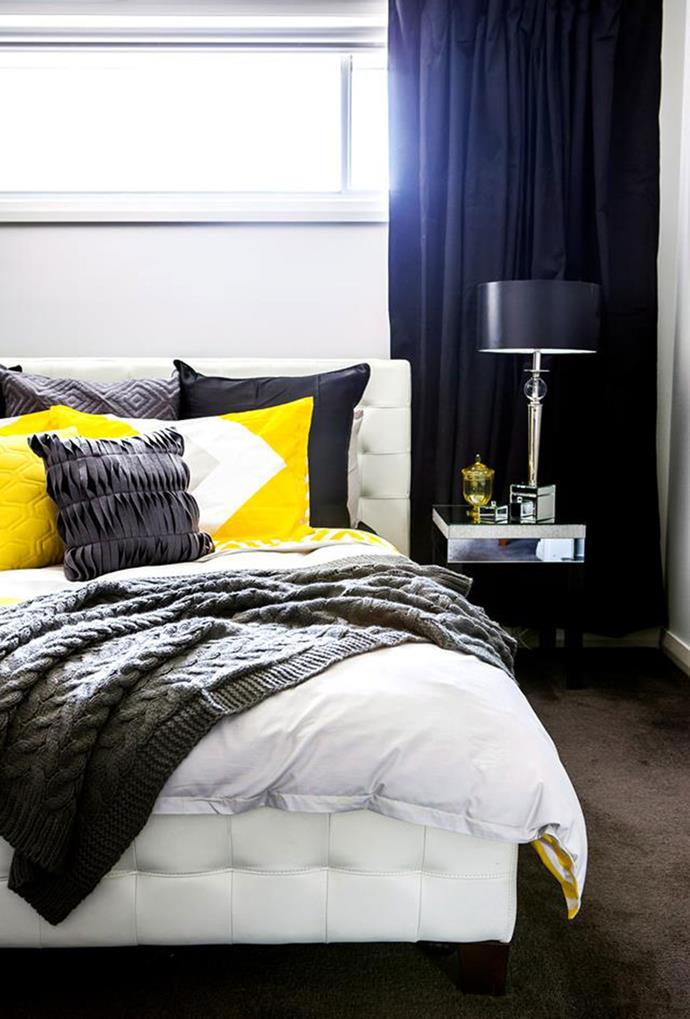 Yellow has been used in this master bedroom to stand out against the mostly dark colour palette, serving as an uplifting shade for winter. *Photo: Maree Homer*