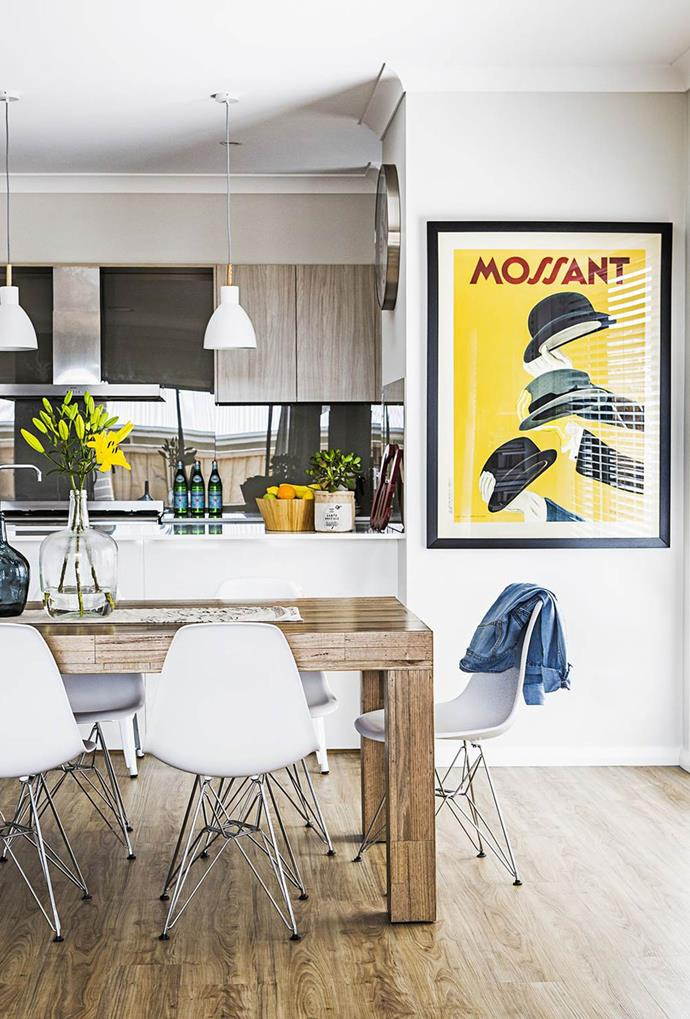 "This yellow-hued contemporary print gives an element of personality to the all-white aesthetic within this [Western Sydney home](https://www.homestolove.com.au/gallery-katie-and-nathans-modern-classic-new-build-1969|target=""_blank""). *Photo: Maree Homer*"