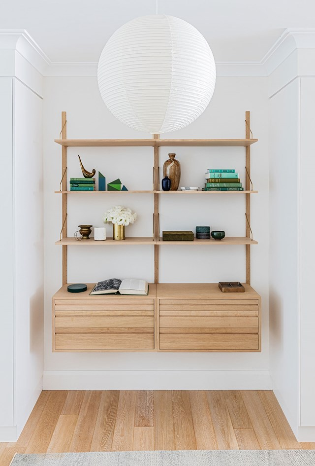 Entryways are often used as a dumping ground for bags, shoes, coats and the rest but not this serene space. A bespoke wall-hung shelving unit provides a place to store bits and bobs as well as display treasured items to create a warm welcome. *Photo:* Felix Forest