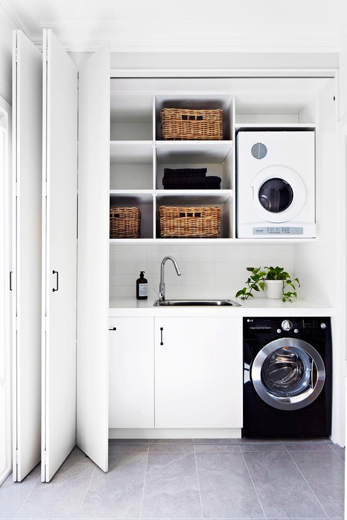 Overhead wall storage is a must in small space laundries. Photo: Armelle Habib /  *bauersyndication.com.au *