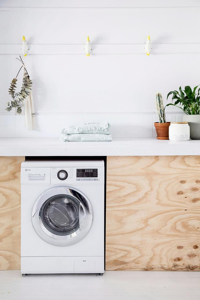 DIY ply cabinetry was a simple and budget-friendly solution for this laundry room. Photo: Chris Warnes / *bauersyndication.com.au *
