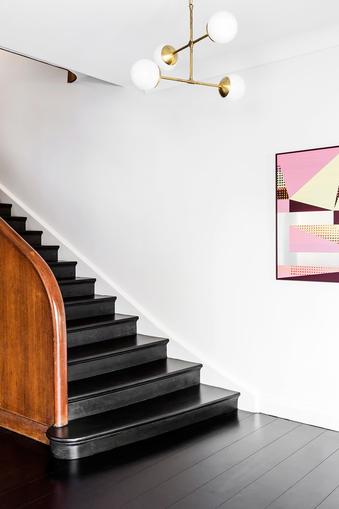 The original curved wood banister was left untouched. Artwork by Will Cooke. Pendant by Douglas & Bec.