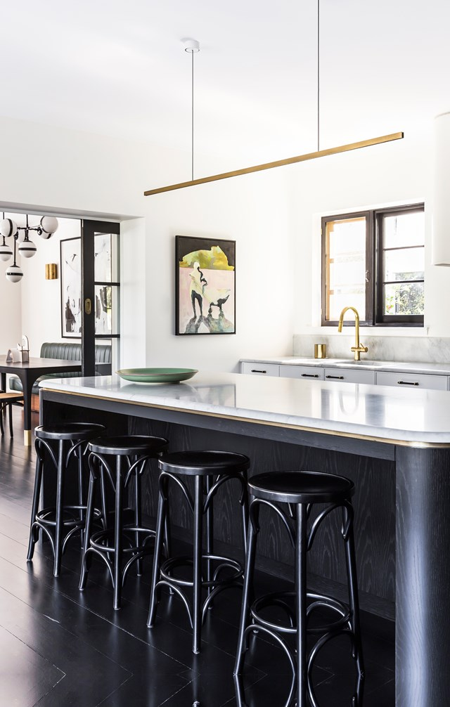 "A monolithic black marble island with brass detailing receives family and guests into this [Spanish mission home](https://www.homestolove.com.au/spanish-mission-home-in-sydney-6324|target=""_blank"") daily."