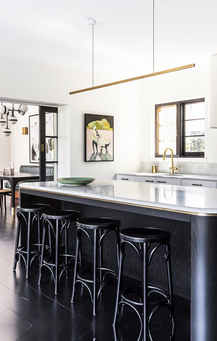 Marble-topped kitchen island with brass detailing. Bentwood stools from Thonet. Brass lightfitting by Rakumba. Artwork by Emilie Syme-Lamont from Curatorial+Co.