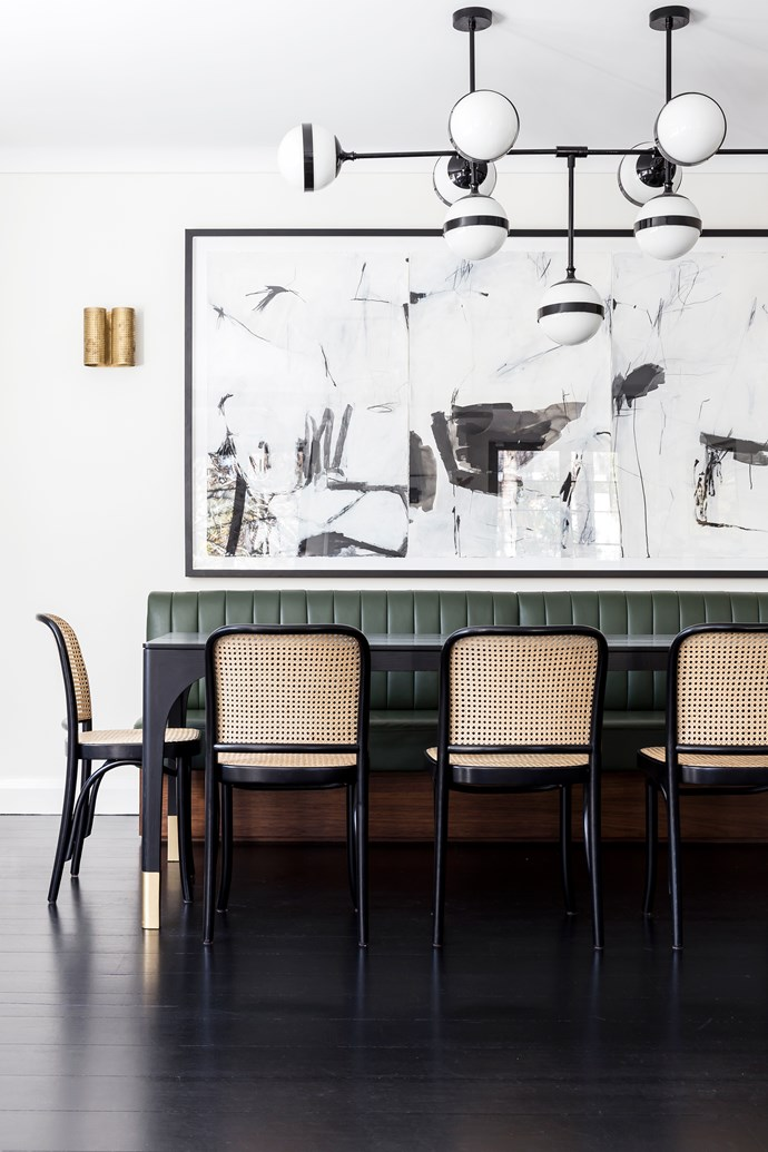 'Hoffmann' chairs fromThonet. 'Peggy Futura' chandelier by Vistosi. Wall sconces by Kelly Wearstler. Artwork, Memory Recaptured Through Daydreams by Antonia Mrljak.