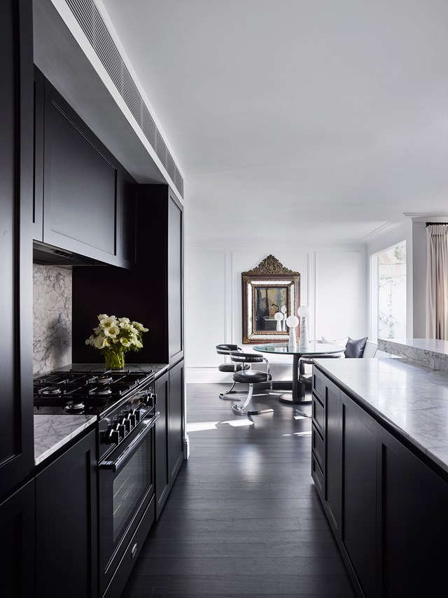 "During the renovation of this [chic inner city terrace](https://www.homestolove.com.au/chic-makeover-of-an-inner-city-terrace-6331|target=""_blank""), the kitchen became a strong sculptural element, imparting character and richness to the interior of the home. *Photo: Derek Swalwell*"