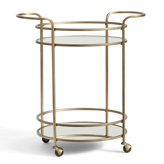 "**Trolleys:** Tristan bar cart, $427 from [Pottery Barn](https://rstyle.me/n/cyx2kwvs36|target=""_blank"")."