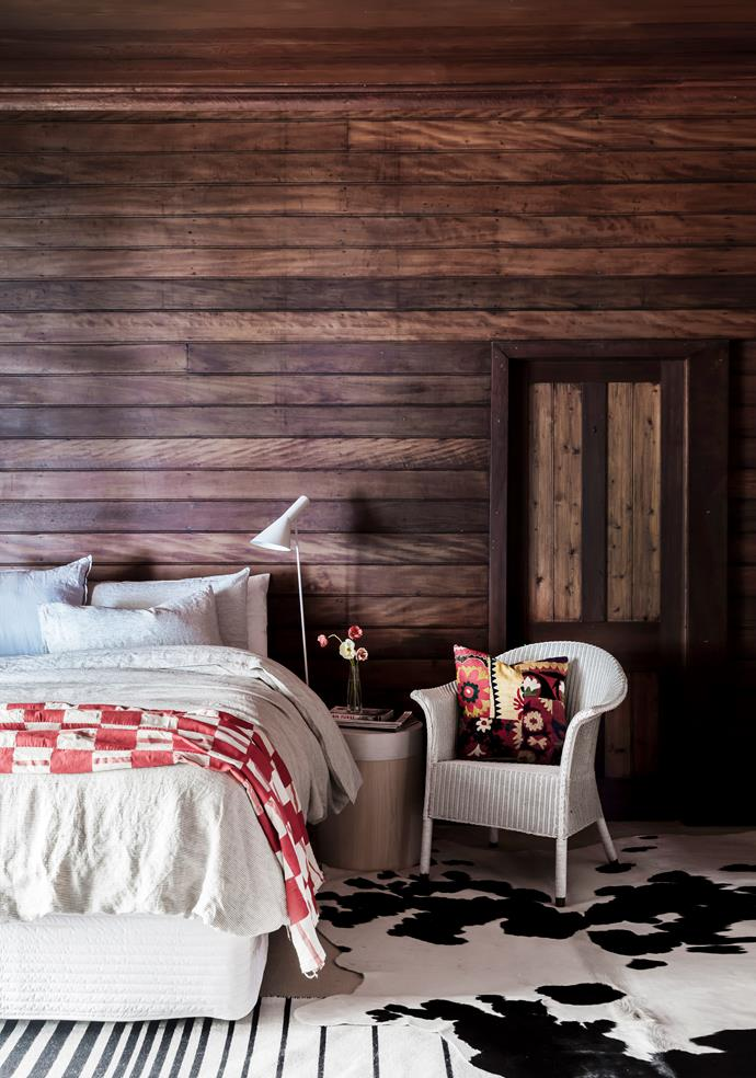 The variegated timbers are displayed in all their glory. Australian House & Garden bedlinen, Myer. Throw from Ghana. Vintage Arne Jacobsen 'AJ' floor lamp. Cushion in a Turkish Suzani fabric. Striped rug, Ikea. Cowhide from roadside stall in the NSW Blue Mountains.