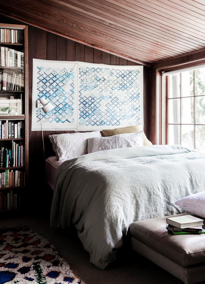 A Quercus & Co 'Tapestry' canvas above the bed picks up the geometric forms in the rug. Linen quilt cover in Celadon Green, Merci.