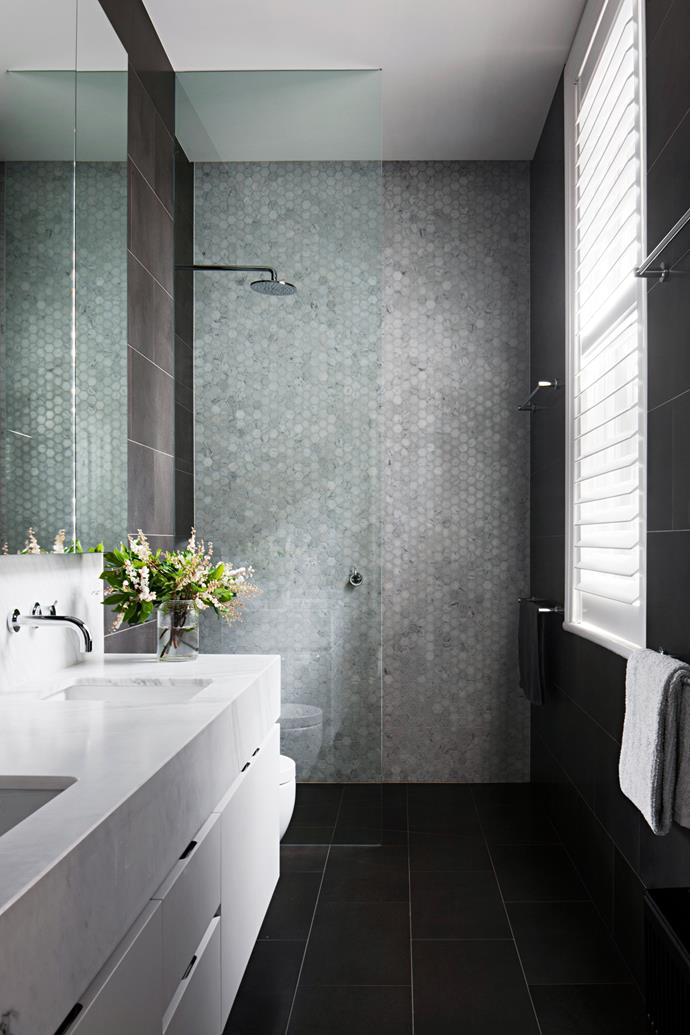 The main bathroom has basalt floor tiles and Carrara marble wall tiles.