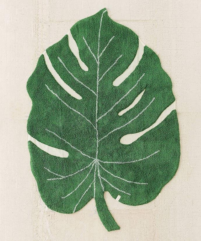 """Monstera Leaf Rug, $225, at [Urban Outfitters](https://www.urbanoutfitters.com/shop/monstera-leaf-washable-rug?category=rugs&color=030