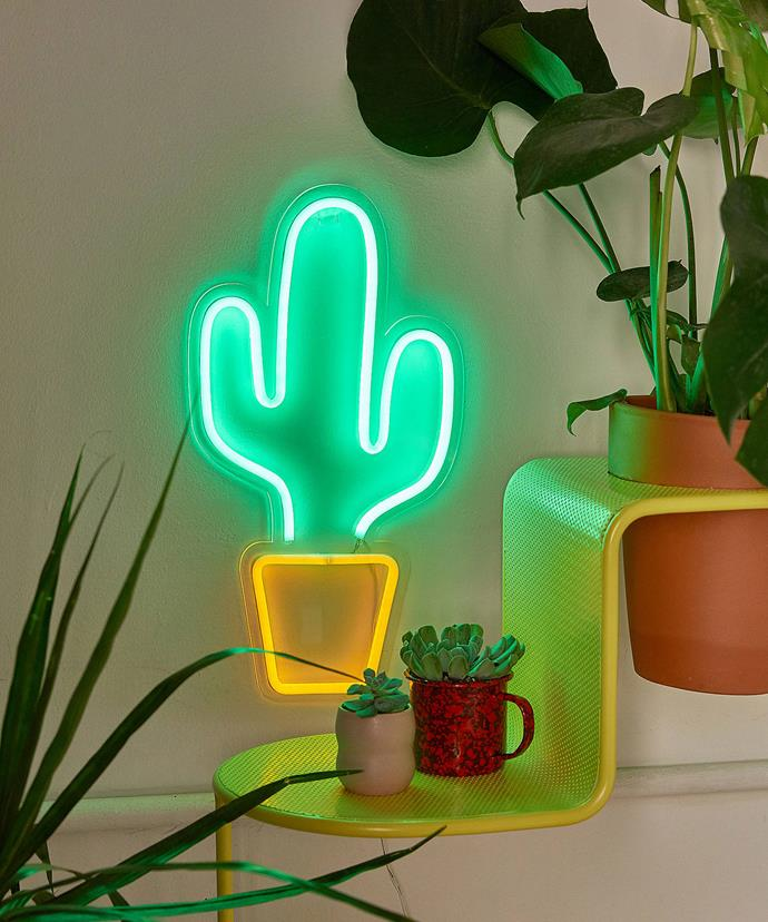 """Potted Cactus Neon Sign, $69, at [Urban Outfitters](https://www.urbanoutfitters.com/shop/potted-cactus-neon-sign?category=lighting&color=030