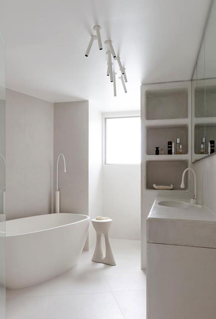 White downlights, together with other all-white appliances create a uniform, yet minimal bathroom space. *Photography: Felix Forest*