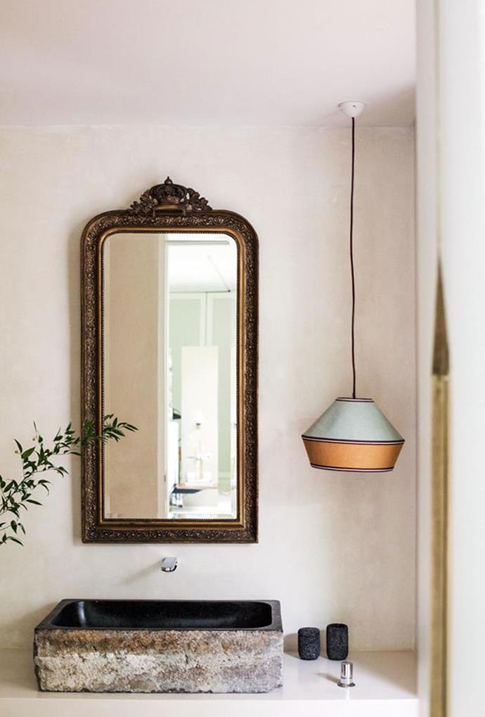 """This multi-coloured pendant light brings an element of personality to the bathroom within this [boutique hotel in Bali](https://www.homestolove.com.au/bali-high-6238