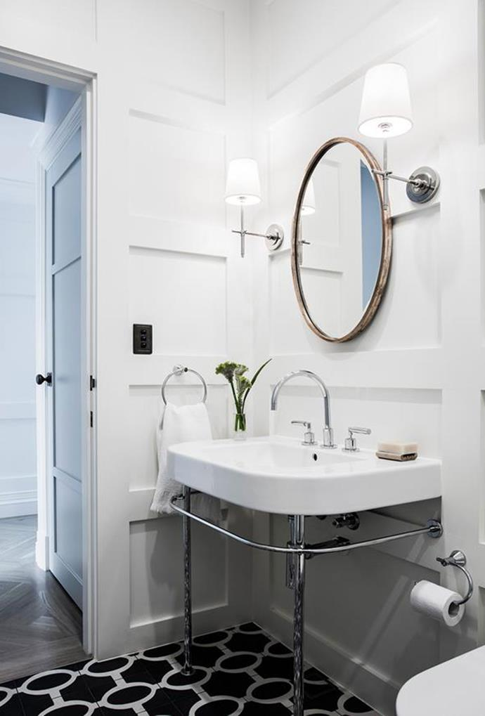 Matching wall lamps have been strategically placed beside the vanity mirror in this bathroom, covering most of your lighting needs.  *Bathroom by Natasha Levak*