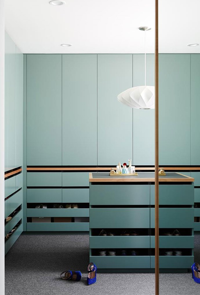 Wall-to-wall storage, paired with a structural pendant light have transformed a tiny bedroom into a dream walk-in wardrobe. *Photo: Annette O'Brien | Story: Australian House & Garden*