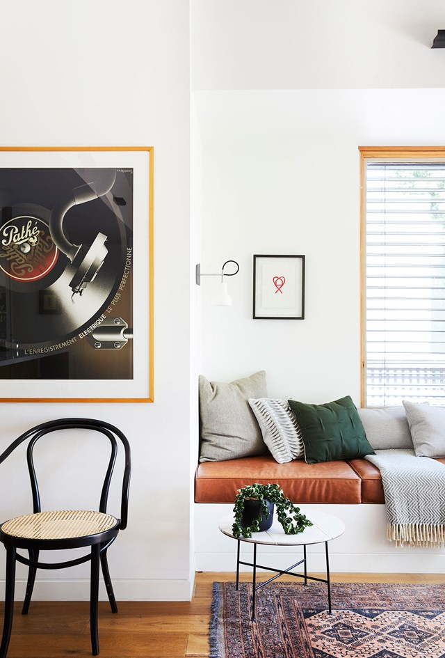 """This recessed window seat provides extra seating as well as a solo relaxation zone. Upholstered in caramel leather, it ties in perfectly with the design of this [modernist style home in bayside Melbourne](https://www.homestolove.com.au/modernist-style-home-melbourne-6369