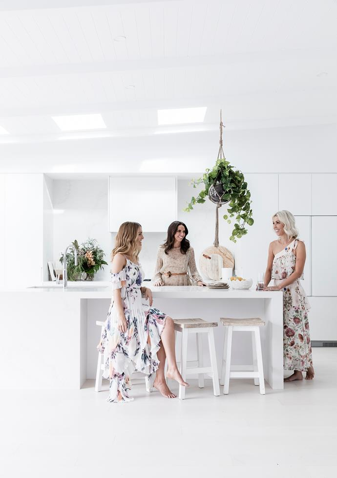Lana, at right, and her fellow Birds Erin and Bonnie are thrilled to have completed another great renovation. To keep the look light and bright, Lana's kitchen features a huge island bench in Caesarstone Calacatta Nuvo and cabinetry in Dulux Lexicon Half by Carrera By Design.