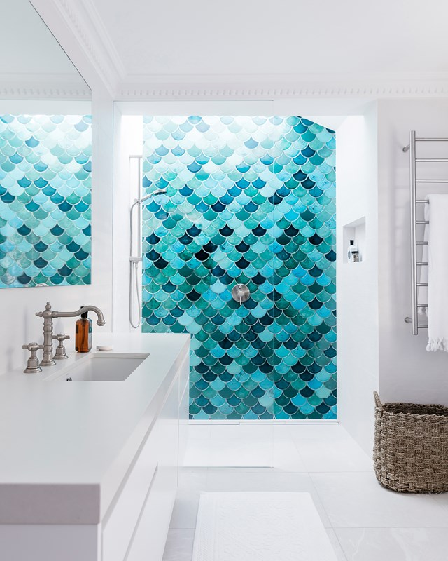 Turquoise Fish-scale tiles from Amber Tiles, turn this simple shower space into a feature.