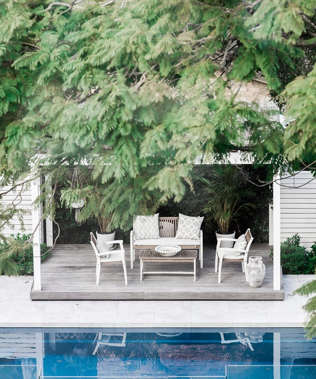 "A poolside cabana creates extra living space away from the house and is just the thing for gathering with friends and family for a casual lunch in between swims. A simple timber setting with texture white furnishings is on theme with the rest of Three Birds Renovations' [Lana Taylor's modern Mediterranean style home](https://www.homestolove.com.au/lana-taylors-modern-mediterranean-style-home-6378|target=""_blank"")."