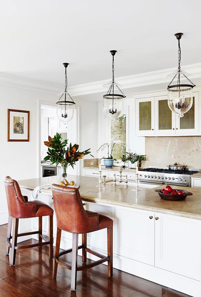 "Hundi pendant lights nod to Hamptons style in this relaxed, yet elegant [French Provincial paradise](https://www.homestolove.com.au/french-provincial-home-in-sydney-5418|target=""_blank"") in Sydney's Eastern Suburbs — making for the perfect entertainers kitchen."