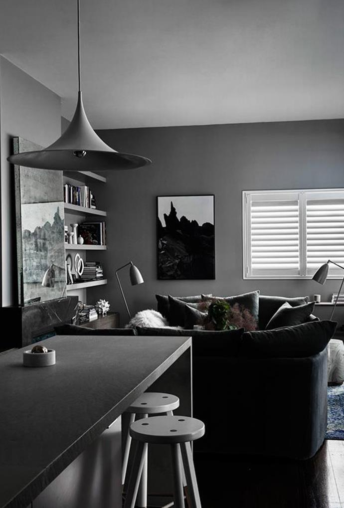 """A dark coloured 'semi' pendant light brings a sense of calm sensuousness to this [Melbourne home](https://www.homestolove.com.au/a-dark-and-sensuous-home-in-melbourne-5671